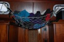 This is a mini hammock that hangs between the two hanging cloths lockers
