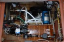 "this shows the new ""on demand"" water pump that replaced our pump and accumulator tank. This gave us room to install the water maker hgh pressure pump. That the blue thing in the middle"