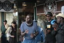Black gospel crew singing outside the original Starbucks store in Pike market