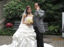 Teen bride, groom on cell phone