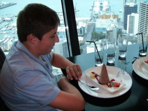 2nd Mate gets an early birthday celebration with ice cream and candles at the Orbit Restaurant in the Sky Tower.