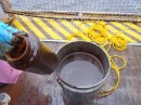 Bucket of oily surface water