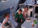 Dave, Dorothy and Gregory relax in the cockpit here in Bequia. Great times had by all.