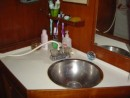 A close up of the wash basin showing the old taps and
