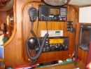 Here you can see my poor attempt at woodwork, thout it has worked ok it could be better. We have a dual station VHF, which can be controlled at helm, and our SSB (an Icom 710) and a pactor modem. On the left you can just see our navtex and above it is a repeater for the autopilot in the cockpit. Next to do is the Furuno chartplotter to the right of the navtex, photos to follow.