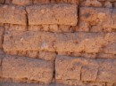 A close up of adobe brick.