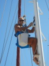Ian cleaning the mast.