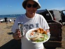 Brent with a plate of food prepared by the local fishermen at Bahia Santa Maria