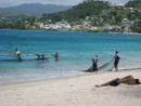 Fishermen checking their nets on Grande Anse beach