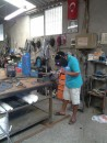 In the Robinson workshop, where they are now working on the dinghy davit