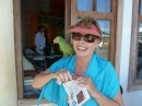 Vicki with a tame Red Lored Amazon parrot in Bocas Town