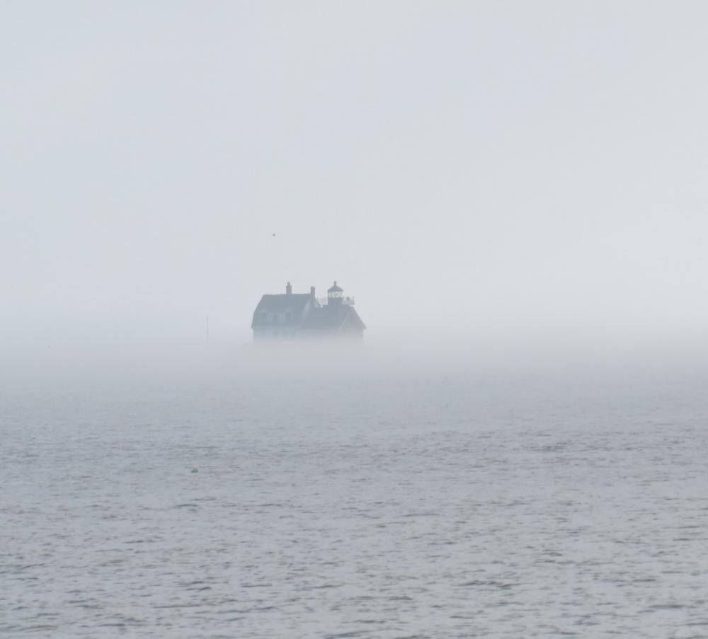 Rockland Lighthouse sits at the end of a 7/8 mile breakwater.  When the fog rolls it, the foghorn sounds.