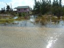 Seawater flooding slowly receding at West End, Grand Bahama