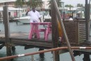 Dock guys nailing down our closely pink picnic table on the dock near us