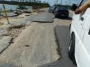 Fishing Hole Road on Grand Bahama where the ocean north and south of the island crosses the road during hurricanes.