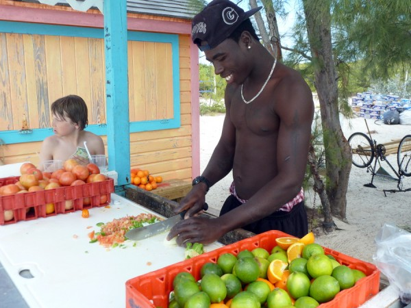 Making fresh conch salad on the beach