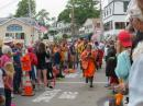 The relay cod race through Boothbay.  Participants need to wear oilskins and race 4 cod around the block.