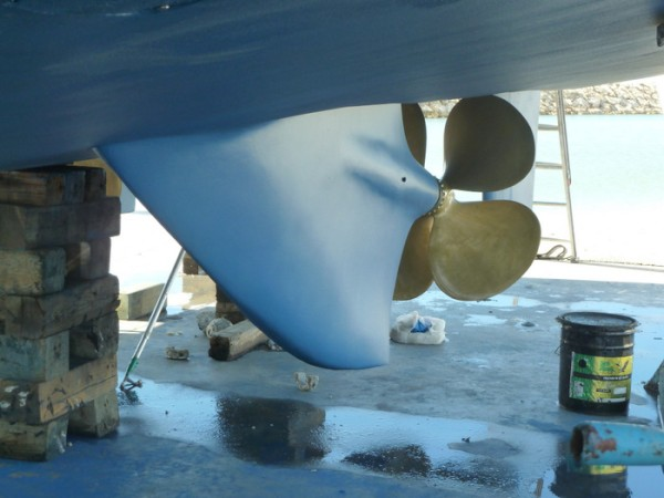 This is the velocity strut keel patented by David Marlow which has the advantage of better straight line performance and protects the rudders and props should one run aground.  The shafts are offset from the rudder which is handy so the shafts can be removed without removing the rudder.