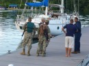 Mike chatting with the Navy personnel about the Jamaican yacht