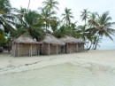 These 3 huts are for rent at the resort on Banedup.  |They contain 1 bed only.  Note the tide coming in.
