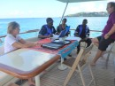 Sitting on the aft deck with our new friends, the Water Police in Montego Bay.