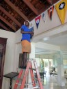 Striking a pose while hanging our RQYS Burgee in the Montego Bay Yacht Club, Jamaica.  If anyone arrives at the Club by sea, please take a picture and send to us.  We