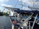 As seen in this picture, Koinonia II is outfitted with 250 watts of solar panels, a D400 wind turbine, and a wifi antennae for picking up those shore hotspots from miles away.  Included is a stern mounted American flag.  Koinonia II is a US documented vessel!