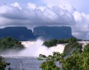 "The main falls at Canaima with 2 tepuis (Flat topped, vertical walled mountains) in the background. These are the mountains that inspired Sir Arthur Conan Doyle to write ""The Lost World""."