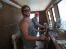 Colter on the helm, Scott behind him