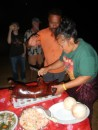 David, our Tongan and his wife, Nietta carving the pig