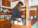 Linda organizing her galley for sea.