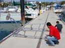 Newly farbicated arch for the new solar panels arrives on the dock at La Cruz, February, 2012.