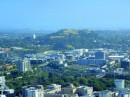 Auckland is built atop numerous volcanic cones  - which are not necessarily extinct -one of which can be seen in the distance here. How