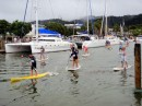 Paddle boarding is very popular in New Zealand; here some paddle board racers head downriver past Bright Angel.