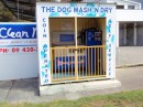 A coin operated dog wash - conveniently located at the coin operated car wash!