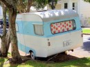 "Kiwis love their ""caravans"" - camper trailers. This one even has a name!"