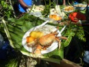 A tempting plate of fresh cooked crab, box fish, paw paw (papaya) and bundi - a banana-like fruit. Delicious!