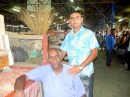 Father and son at their stall in the Labasa market.
