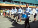 The local drum corps marching in the parade.