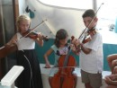 "the ""Chagos Trio"", Emily first violin, Elora cello, Alexis violin, performes on board ""Arctracer"""