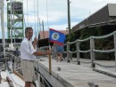 Hoisting the Belize Courtesy flag after checking in