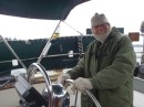 Bob at the helm as I head up to rais the sails.