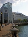 Our dingy is tied next to ladder in front of the Great Lakes Science Center which is right next to......