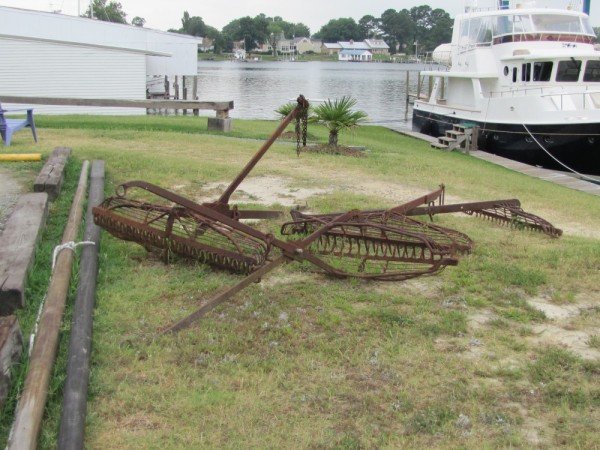 We photographed a fisherman tonging for oysters on the bay and spotted these tongs in the yard at the Deltaville Marina.