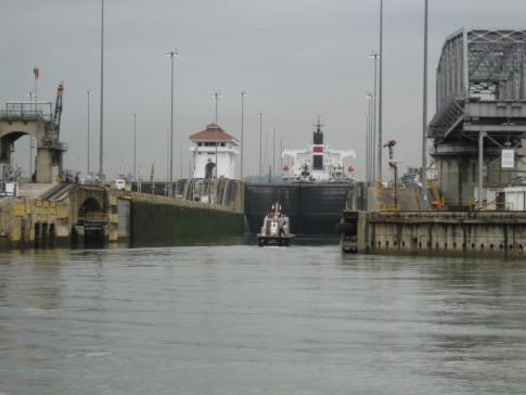 Here we are approaching the first lock on the Pacific side of the canal.  There are two locks in a row at what is called the Miraflores locks.