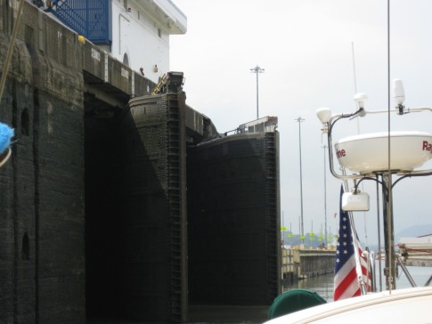 This photo is a little out of sequence as its from the Miraflores locks.  It shows the curved shape of the leaves that make up the gates of the locks.  The locks are double to provide some insurance against an accident that might damage one set of locks and allow Lake Gatun to drain into the ocean.  An accident like that would put the canal out of commission for months wihile the water levels in the lake were allowed to build up again.  The gates dont close flat.  See the album on our Miraflores tour for more detail about how the gates work.