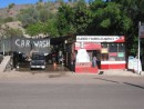 "This is another photo that shows the interesting juxtapositions seen in Mexico.  Unfortunately you cant read the sign in front of the restaurant in the photo but it assures the reader that it has the ""best fish tacos""....and a car wash, what else could you as for?"