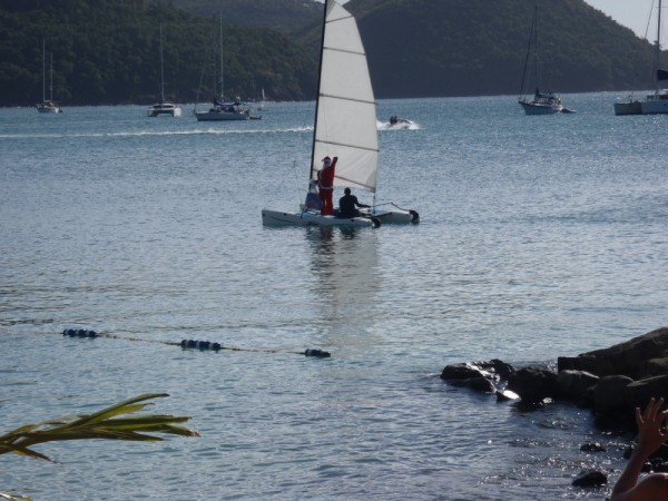 Santa arrives sailing a Hobie cat, of course