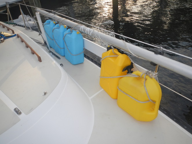 Jerry Jugs on the Rail: The blue jug holds water. The yellow one holds diesel fuel.
