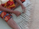 Grammas of the villages often seem to be the ones weaving the mats.